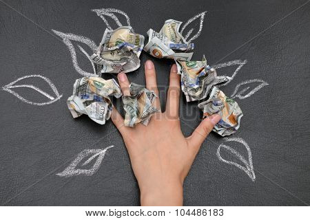 Money tree drawing on blackboard close up