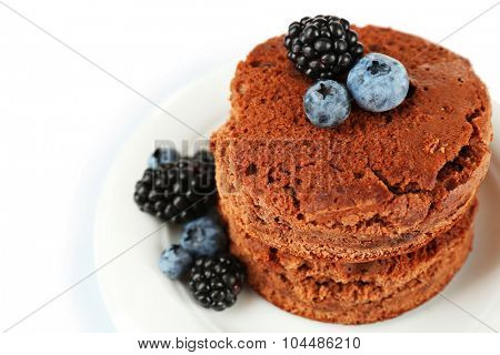 Cake with berries on plate isolated on white