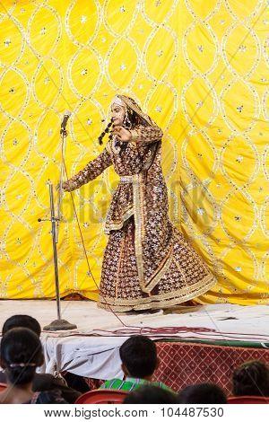 Woman dancing during the Ganpati Festival.