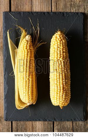 Fresh corn over slate background
