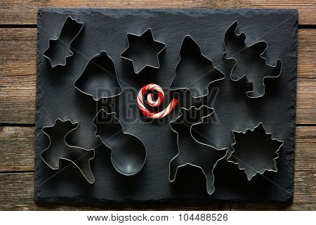 Christmas cookie cutters on slate