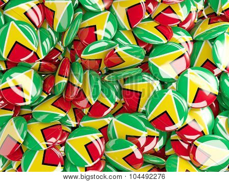 Background With Round Pins With Flag Of Guyana