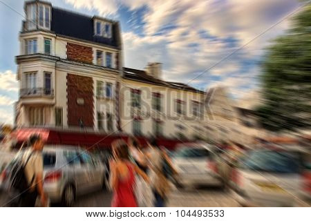 Abstract Background. Tourists Walking On Montmartre.  Blur Effect Defocusing Filter Applied