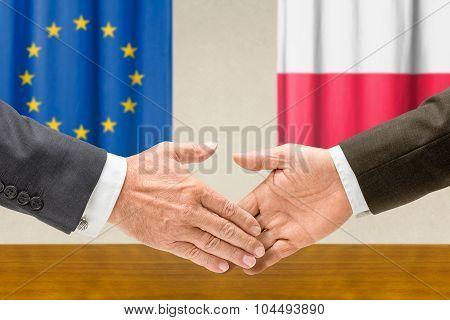 Representatives Of The Eu And Poland Shake Hands