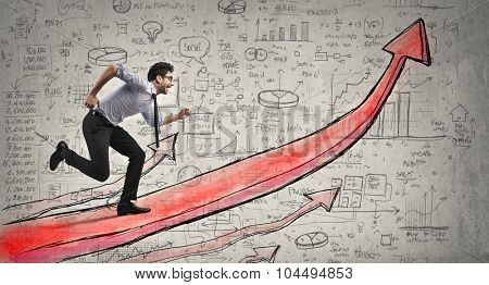 Businessman running upon a red arrow