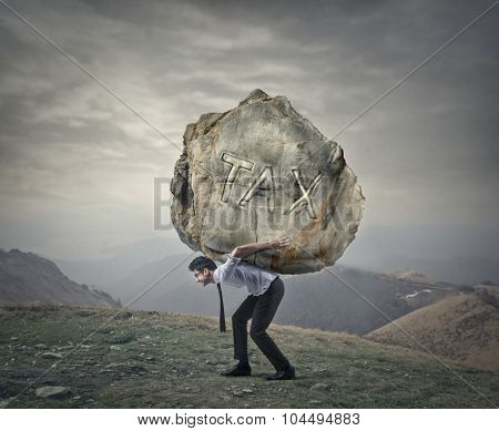Man carrying a heavy rock
