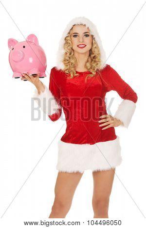 Santa woman holding a piggy bank.