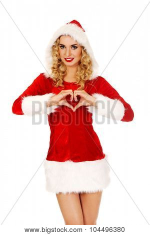 Santa woman doing a heart with her hand.