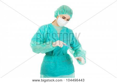Female surgeon doctor with a scalpel performs the surgery.