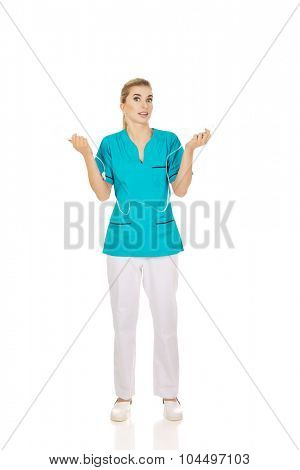 Young shocked nurse holding a drip.