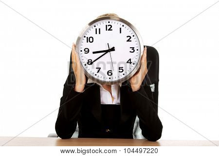 Businesswoman hidden behind the clock.