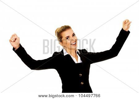Young happy businesswoman with arms up. Winning concept.