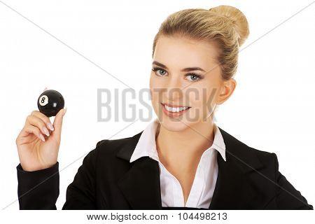Happy businesswoman holding eight billiard ball. Winnig concept.