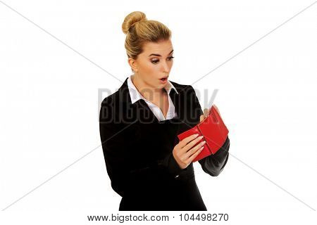 Young caucasian woman with empty wallet - broke.