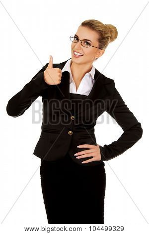 Happy smiling business woman with ok hand sign.
