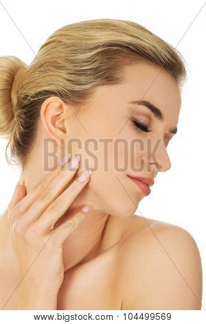 Young beautiful spa woman touching her face