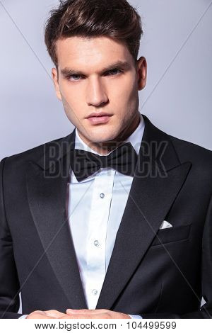 Close up portrait of a young handsome business man wearing a tuxedo.