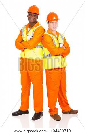portrait of industrial workers standing back to back on white background