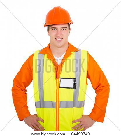 portrait of smiling young contractor on white background