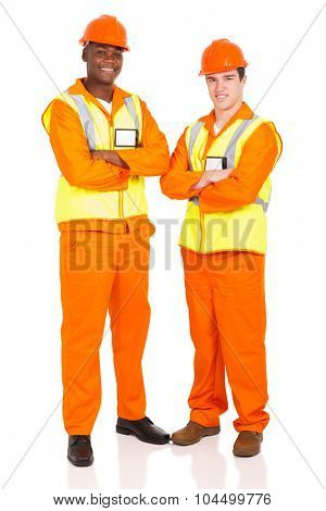 portrait of smiling male contractors with arms crossed