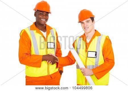 happy male industrial co-workers handshaking