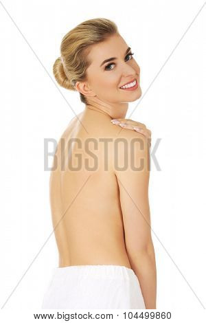 Young smile beautiful topless woman with white towel around her waist.