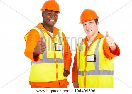 happy young engineers giving thumbs up