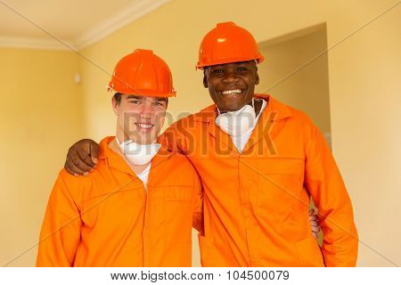 multiracial craftsmen standing in a house during renovation