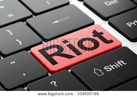 Political concept: Riot on computer keyboard background
