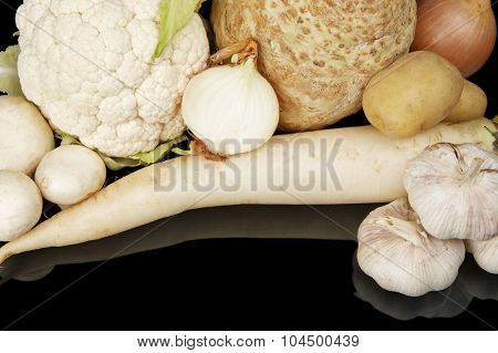 Collection Of White Vegetables On Black Top View