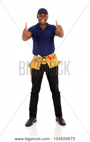 cheerful young afro american handyman giving thumbs up on white background