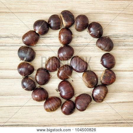 Chestnut Peace Symbol On The Wooden Plate