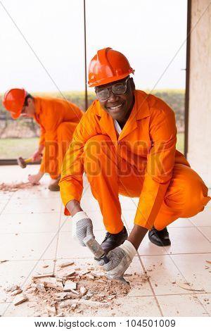 happy african builder building renovations
