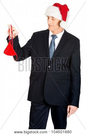 Santa businessman with female thongs hanging on finger