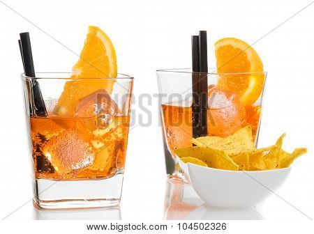 Glasses Of Spritz Aperitif Aperol Cocktail With Orange Slices And Ice Cubes Near Tacos Chips