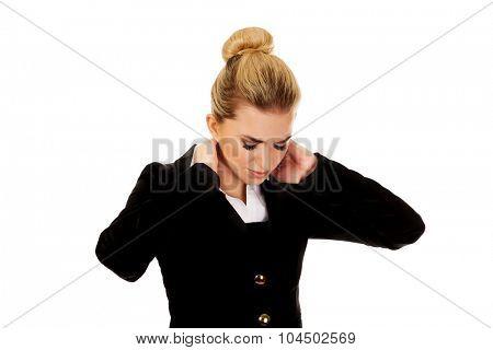 Businesswoman having huge neck pain.