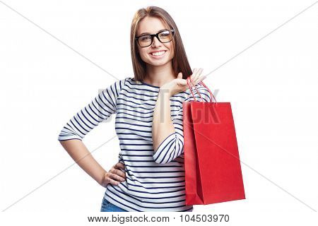 Happy shopper in eyeglasses looking at camera