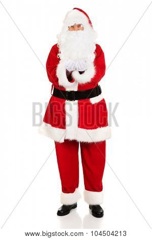 Full length Santa Claus with open hands.