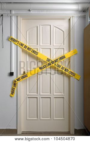 Crime scene closed with yellow stripes