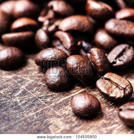 Top View Of Coffee Beans On Dark Vintage Background