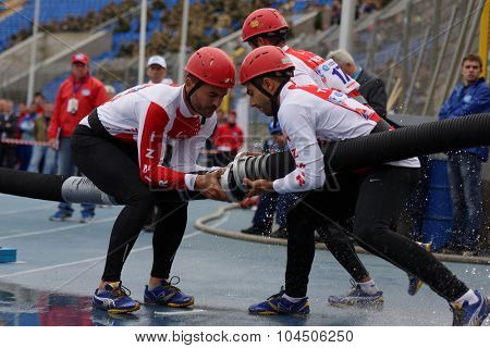 ST. PETERSBURG, RUSSIA - SEPTEMBER 9, 2015: Team Turkey during competitions in combat deployment during the XI World Championship in Fire and Rescue Sport. First World Championship was held in 2002