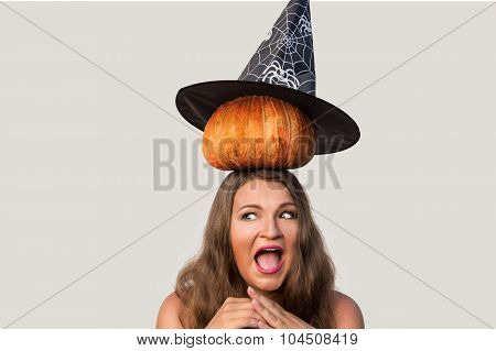 Scared Young Woman With Halloween Pumkin And Witch Hat On Her Head