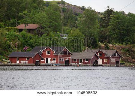 Red Houses On A Lake Coast