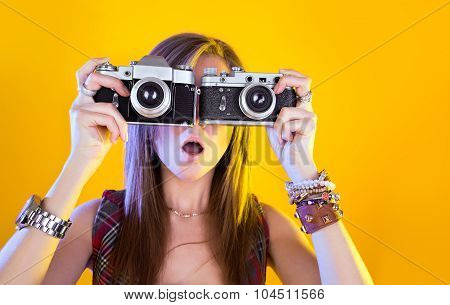 Portrait Of Funny Girl With Two Cameras In Their Hands. Surprised By Samer Looking At Viewer. Isolat