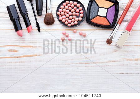 Cosmetics make-up on white wooden. background. Top view mock up.