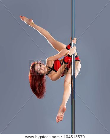 Beautiful young sexy pole dance woman isolated