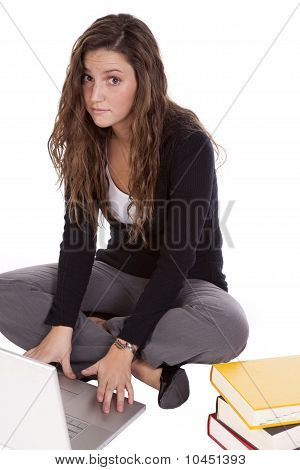 Woman Sitting With Books And Laptop