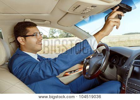 Businessman driving his car