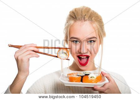 White-haired Girl Eating Sushi With A Chopsticks, Isolated