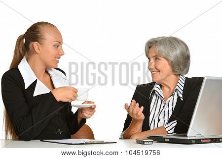 Two businesswomen sitting at table